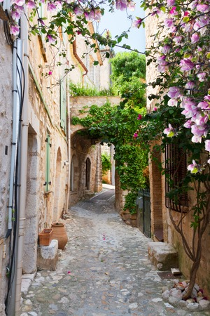 archways: beautiful old town stone street of Provence at spring day, France Stock Photo