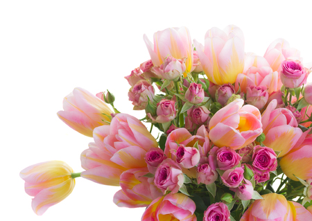 Bouquet of fresh pink and yellow tulips and roses Stock Photo