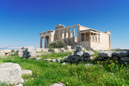 Erechtheion temple with green grass in Acropolis of Athens, Greece