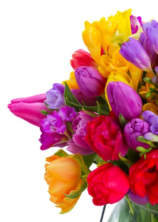 bunch of bright spring flowers close up isolated on white background
