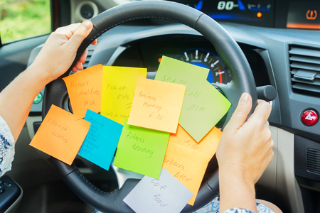 To do list in a car on driving wheel - busy day concept Banco de Imagens