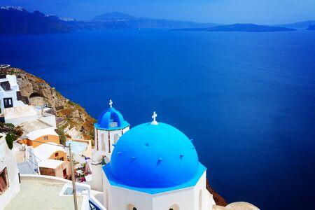view of caldera with blue church domes, Oia, Santorinir, retro toned Stock Photo
