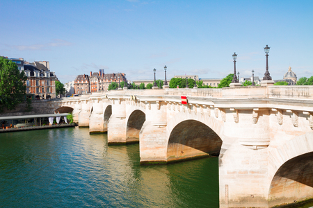Pont Neuf and river Seine waters at sunny summer day, Paris, France