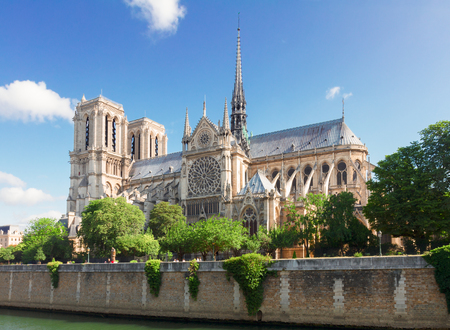 famous Notre Dame cathedral church at summer day, Paris, France