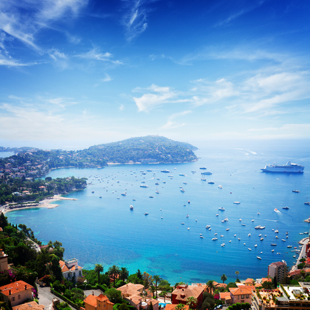 villefranche sur mer: landscape of riviera coast, turquiose water and clear blue sky of cote dAzur at sunny summer day, France, retro toned