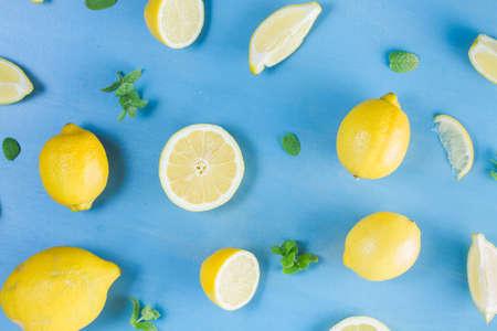 bakground: Fresh lemon citrus fruits pattern on blue bakground