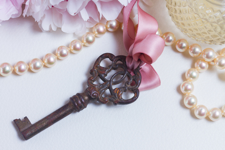 Skeleton key with peony flowers - love and wedding concept Stock Photo