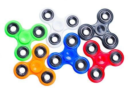cool gadget: set of fidget spinners isolated on white background, popular relaxing toy, generic design