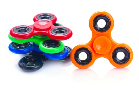 cool gadget: multicolored fidget spinners isolated on white background, popular relaxing toy, generic design Stock Photo