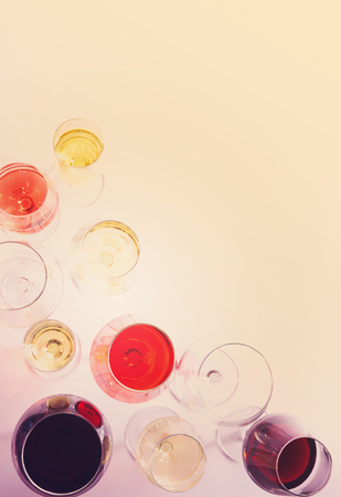 abstract liquor: Set of glasses with red, white and rose wine, top view scene with copy space, retro toned Stock Photo