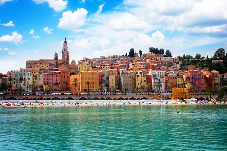 colorful houses of Menton old town hill waterfront, France, retro toned