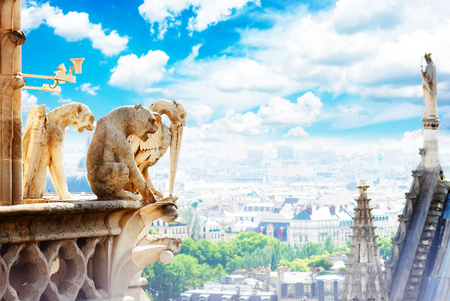 Gargoyles of Paris on Notre Dame Cathedral church and Paris cityscape from above, France, retro toned