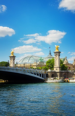 famous Bridge of Alexandre III and Grand Palais over river Seine at summer day, France, retro toned Stock Photo