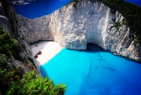 Navagio beach, famous overhead summer lanscape of Zakinthos island, Greece, retro toned