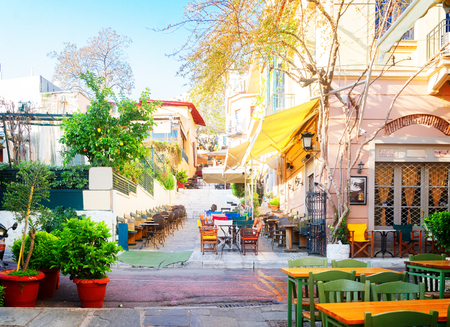 small cosy street of famous Placa district in Athens, Greece, retro toned