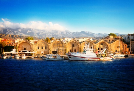 view of bay with historical houses and boats at sunny summer day in Chania, Crete, Greece, retro toned Reklamní fotografie