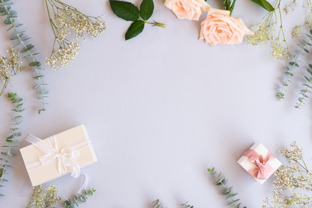 gift or present box and flowers on blue table from above, flat lay frame Archivio Fotografico
