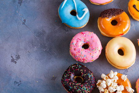 sweet doughnuts on gray stone background with copy space Stock Photo - 86095007