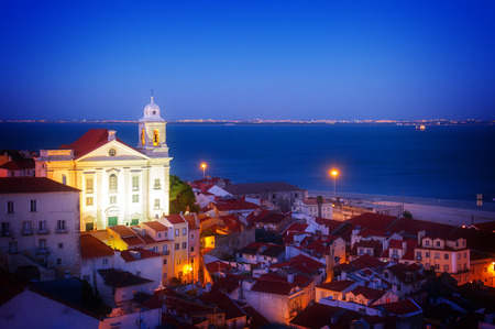 view of Alfama old town at night, Lisbon, Portugal, retro toned