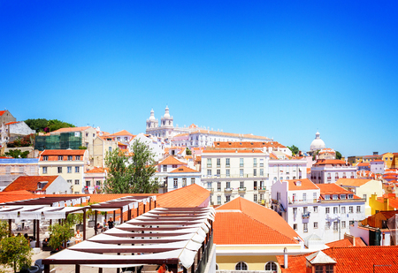 view of Alfama old town skyline at sunny day, Lisbon, Portugal, retro toned