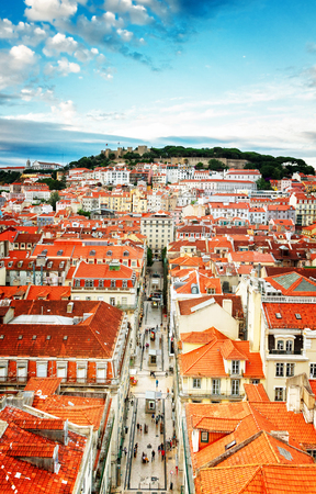 Saint Georges Castle and Lisbon old town from Santa Justa mirador, Portugal, retro toned