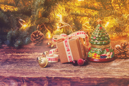 Handmade gift box with vintage evergreen tree on wooden background, retro toned Stock Photo