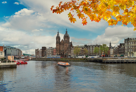 Amsterdam skyline with Church of St Nicholas over old town canal, Amsterdam, Holland at autumn day Stock Photo
