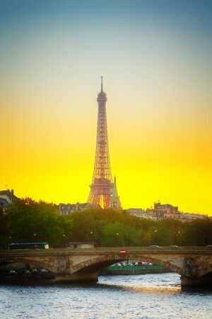 Eiffel tower over Alexandre III Bridgeat at sunset, Paris, France, retro toned Stock Photo
