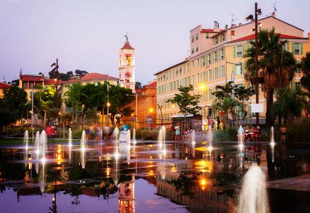 citys street scene of Nice city centre at night, cote dAzur, France, retro toned