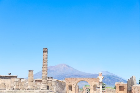 ruins of Pompeii with Vesuveus volcano in background, Italy