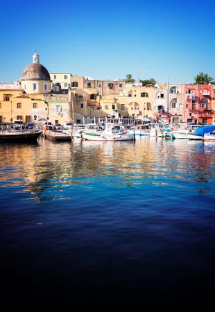 Marina Grande Port with colorful old houses of Procida island, Italy, retro toned