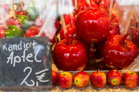 Christmas market food - red apples coated in caramel Stock Photo