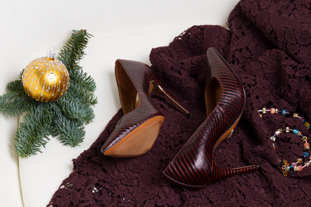 Pair of hight heel shoes and elegant laced dress for Christmas party Foto de archivo
