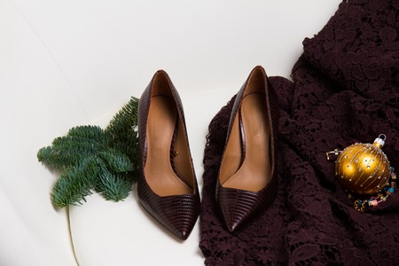 Pair of hight heel brown shoes and elegant laced dress for Christmas party Stock Photo