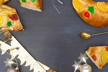 Roscon de Reyes traditional spanish cake for Epiphany festivites, top view scene with copy space