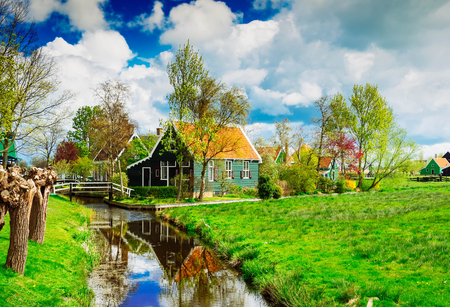 rural dutch scenery of small traditional town Zaanse Schans, Holland, toned