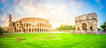 ruins of antique Colosseum and Arch of Constantine in sunise lights, Rome Italy, retro toned