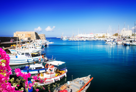 Heraklion old venetian harbour with colorful small fishing boats, yachts and ships, Heraclion Crete, Greecer with flowers