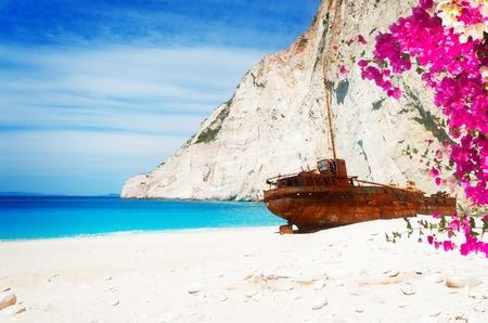 Navagio Shipwreak beach of Zakinthos island, Greece with flowers