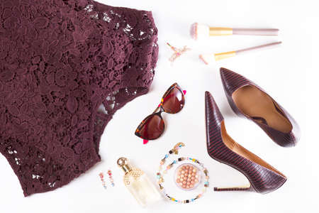 Fashion flat lay scene. Hight heel shoes, lacy dress, dressing up for party fashion accessoires. Stockfoto