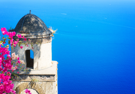 Belltower with the sea in Ravello village with flowers, Amalfi coast of Italy, retro toned Banque d'images