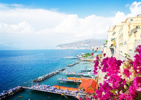 embankment and beach of Sorrento with flowers, southern Italy, retro toned Banque d'images - 95764090