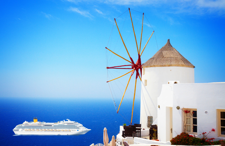 windmill of Oia with cruise ship at sunny day, Santorini Stock Photo
