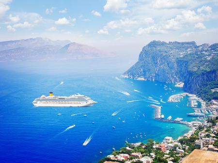 Marina Grande habour with cloudy sky with criuse ship, Capri island, Italy