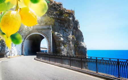 famous picturesque winding road of Amalfi coast with lemons, Italy