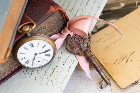antique clock, skeletone key and mail with copy space
