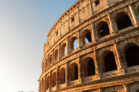 ruins of Colosseum at sunrise light in Rome, Italy Imagens