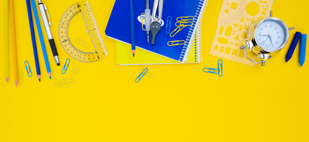 back to school styled blue and yellow scene border with school supplies banner Stock Photo