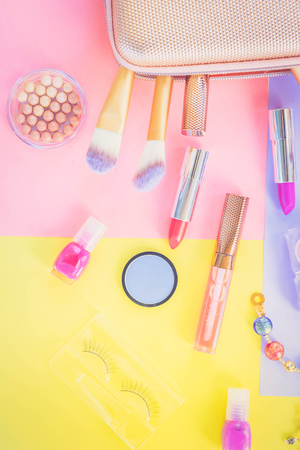 Colorful make up products with pursue pop art flat lay scene, retro toned Imagens