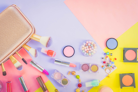 Colorful make up products material design flat lay scene with copy space, retro toned 版權商用圖片